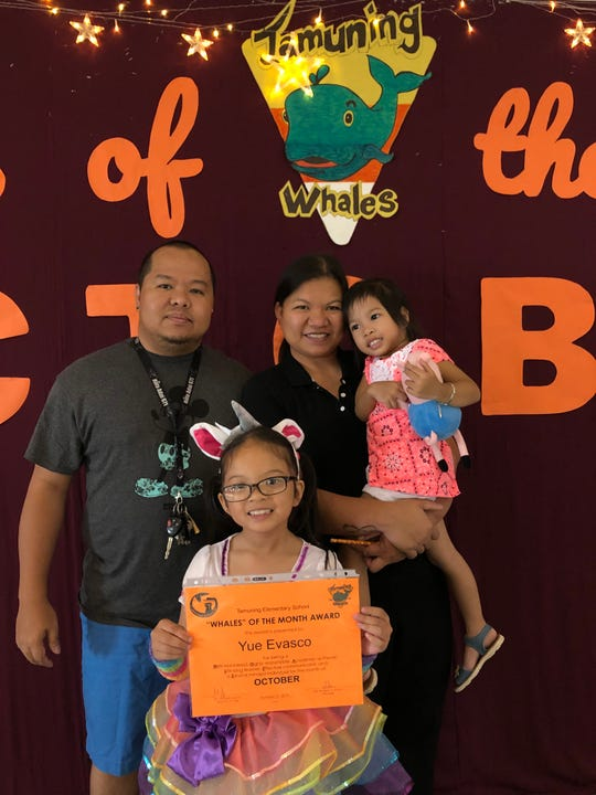 Yue Evasco, second grade was awarded October Whale of the Month on Oct. 31 from Michelle Luzano's class at Tamuning Elementary School. Evasco is pictured with her dad, Michael, mom, Clarissa, and little sister, Sky