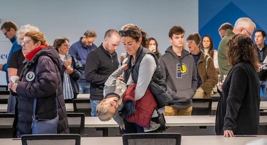"""Emmalee Hinton jokes with her son, Turner, 3, while waiting in line to vote at the Zionsville Town Hall on Tuesday, Nov. 5, 2019. According to the voting site's Republican poll judge Denise Long, """"The line has been like this since 6 a.m."""""""