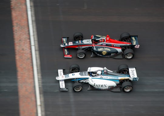 May 24, 2019; Indianapolis, IN, USA; Indy Lights driver Oliver Askew (28) crosses the finish line alongside Ryan Norman (48) to win the Freedom 100 at Indianapolis Motor Speedway.