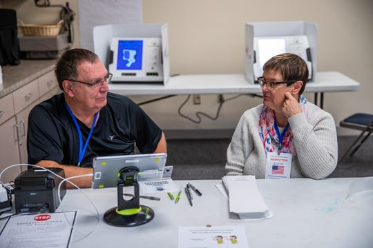"""""""We've already had 41 people by 7:45 a.m., which actually is a good turn out,"""" said Westside Church of the Nazarene voting site inspector Patty McKinnon (right) on Tuesday, Nov. 5, 2019. McKinnon has worked together with her husband Ken Duggins (left) on election day for 10 years. The two have been married for 23 years."""