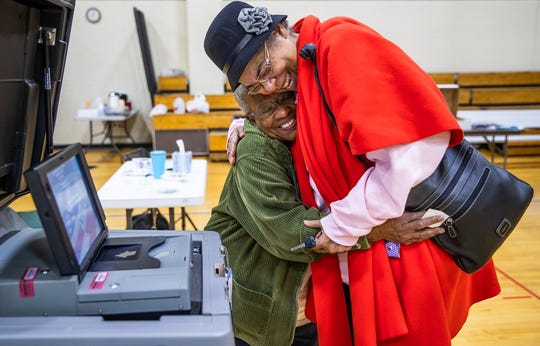 """Patrice Harris, of Indianapolis, said she received a text from her auntie in the morning telling her to go vote on Tuesday, Nov. 5, 2019. """"I'm cancer free and I said, 'I'm going to go vote,'"""" Harris said. In 2017, Harris was diagnosed with pancreatic cancer and recently received the news that she is now cancer free. Municipal Gardens voting site clerk Donna Brown gives Harris a hug after she cast her ballot."""