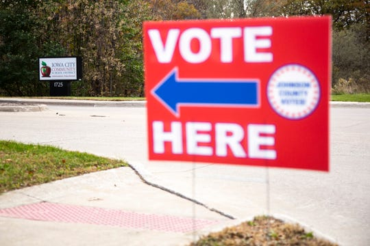 "A ""Vote Here"" sign directs people towards precinct 23 during the first combined city and school board elections, Tuesday, Nov., 5, 2019, at the Iowa City Community School District (ICCSD) offices in Iowa City, Iowa."
