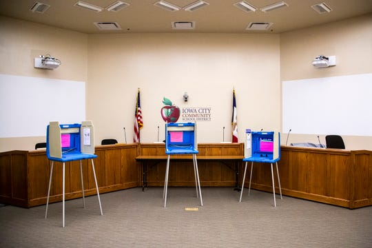 Empty voting booths are pictured during the first combined city and school board elections, Tuesday, Nov., 5, 2019, at the Iowa City Community School District (ICCSD) offices in Iowa City, Iowa.