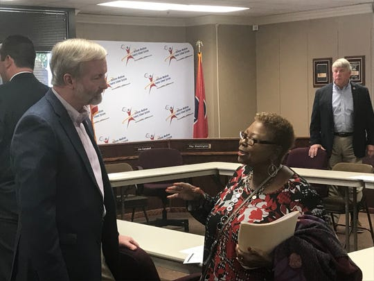 State Rep. Chris Todd and Jackson-Madison County School Board member Doris Black have a discussion after their meeting on Monday.