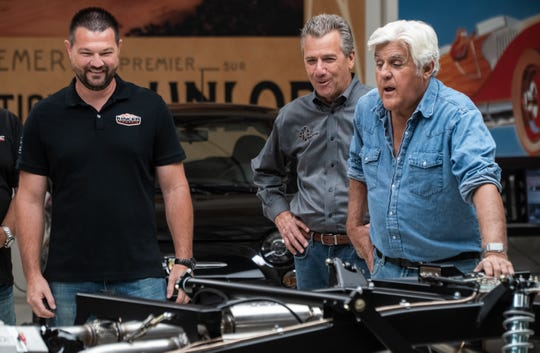 Thomas Kincer, left, owner of Kincer Chassis, with Jay Leno and Mike Spagnola who oversees the SEMA Product Development Center.