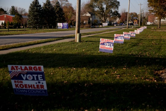 Lawn signs line Dayton road, the street of Dayton's only polling location, Dayton United Methodist church, Tuesday, Nov. 5, 2019 in Dayton.