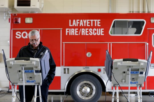 Larry Rainford of Lafayette casts his ballot at Lafayette Fire Station #5, Tuesday, Nov. 5, 2019 in Lafayette.
