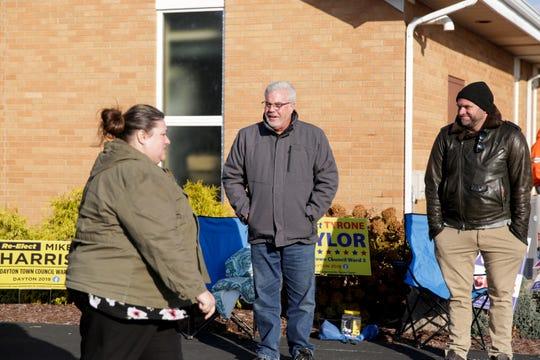 Candidates Ashley Stevenson, Dayton Town Council at-large, and Tyrone Taylor, Dayton Town Council Ward 3, greet voters outside Dayton Methodist Church, Tuesday, Nov. 5, 2019, in Dayton.