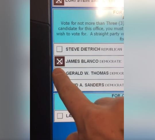 West Lafayette voter Robert Kurtz shows the difficulty he had selecting candidates on voting machines the switched his choices on Election Day, Tuesday, Nov. 5, 2019.  Similar problems happened to voters during the November 2018 election.