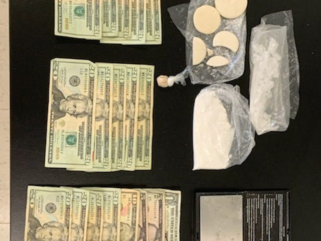 Drugs, money and paraphernalia that the St. Landry Parish Sheriff's Office said it found while searching Paulos Breaux's car.