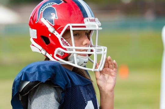 Comeaux High Spartans kicker Savannah Sales (18) practices Tuesday, Nov. 5, 2019.