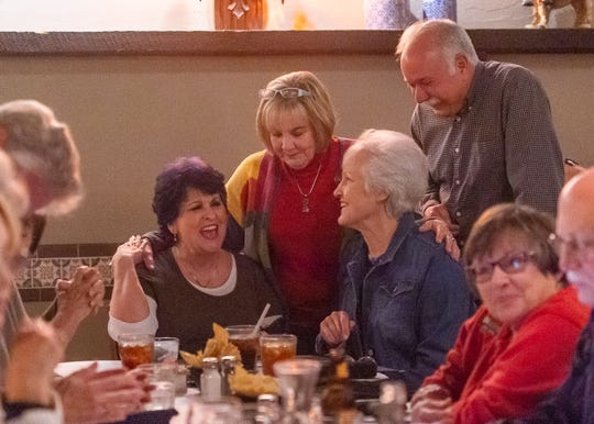 Ann Taylor laughs as she catches up with Coco Montgomery and Sue and Ken Trahan, fellow members of Lafayette High School's class of 1967, at La Fonda restaurant in Lafayette, LA.  Friday, Nov. 1, 2019.