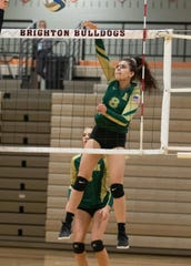 Reegan Crowley of Howell smashes the volleyball over the net against South Lyon East in a district match on Monday, Nov. 4, 2019 in Brighton.