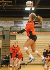Brighton's Elaine Halonen spikes the volleyball in a district match against Hartland on Monday, Nov. 4, 2019.