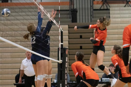 Celia Cullen of Brighton spikes the volleyball past Cora Wightman and Megan Archer of Hartland in a district match on Monday, Nov. 4, 2019.