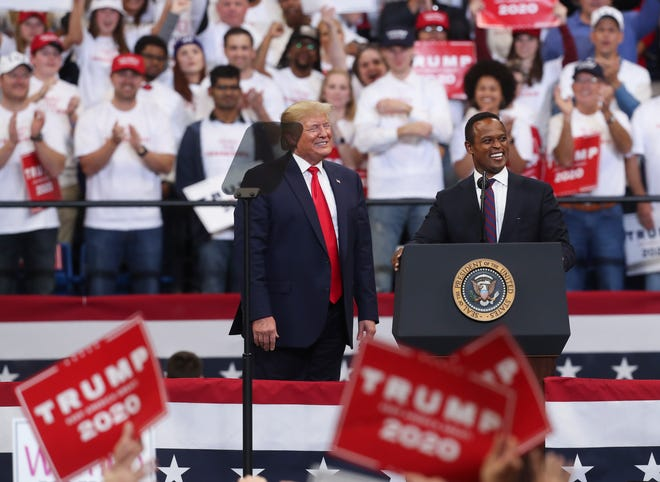 President Donald Trump, left, brought candidate for Kentucky attorney general Daniel Cameron up to the stage after he made remarks supporting him at Rupp Arena in Lexington, Ky. on Nov. 4, 2019.
