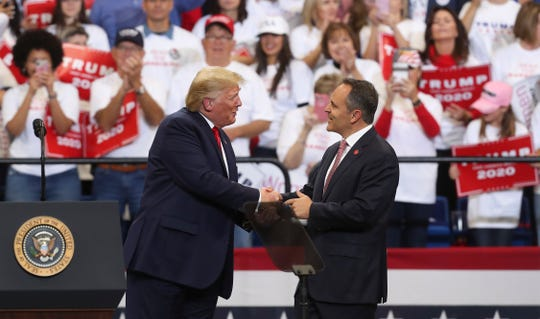 President Donald Trump, left, brought Gov. Matt Bevin up to the stage after he made remarks supporting Bevin's re-election at Rupp Arena in Lexington, Ky. on Nov. 4, 2019.