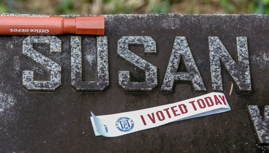 """An """"I Voted Today"""" wristband on the grave of Susan Look Avery at Cave Hill Cemetery was part of the tour of area suffragists on election day.  The tour was put on by the League of Women Voters Louisville, Frazier History Museum, Friends of Eastern Cemetery and Cave Hill Cemetery.November 5, 2019"""