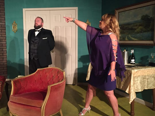 """Johnna Gustafson gestures as Jason Whitehead stands in place during rehearsal for """"The Dinner Party."""""""