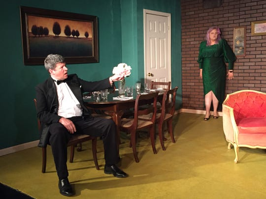 """Eric Gustafson and Laura Ritchie take part in a scene at a rehearsal for """"The Dinner Party,"""" a Neil Simon play."""