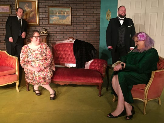"""Steve Russell, Misti Tidman, Jason Whitehead and Laura Ritchie practice for """"The Dinner Party,"""" the latest from the Mansfield Playhouse."""