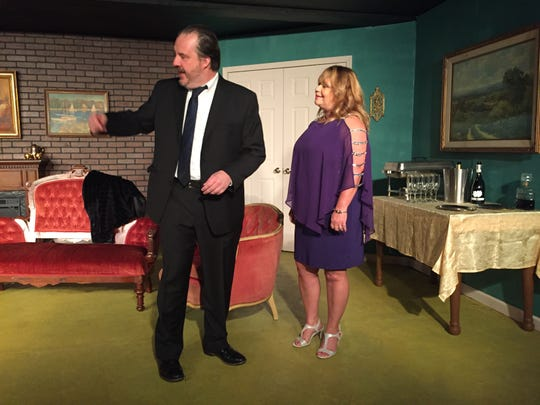 """Steve Russell and Johnna Gustafson rehearse a scene from """"The Dinner Party,"""" a Neil Simon play."""