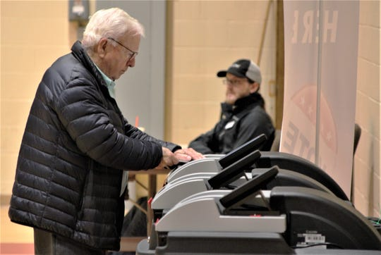 A Marion County resident feeds his ballot into a machine to be processed after voting on Tuesday at Dayspring Wesleyan Church.