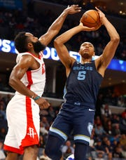 Memphis Grizzlies forward Bruno Caboclo shoots the ball over Houston Rockets guard James Harden during their game at the FedExForum on Monday, Nov. 4, 2019.