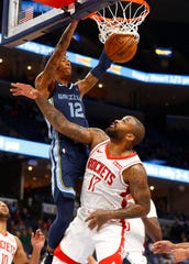 Memphis Grizzlies guard Ja Morant dunks the ball over Houston Rockets forward PJ Tucker during their game at the FedExForum on Monday, Nov. 4, 2019.