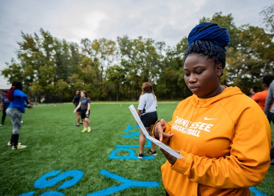 Freedom Prep's girls' rugby team coach Faith Walker looks over the schedule during a practice session at David Carnes Park Tuesday Oct. 29, 2019