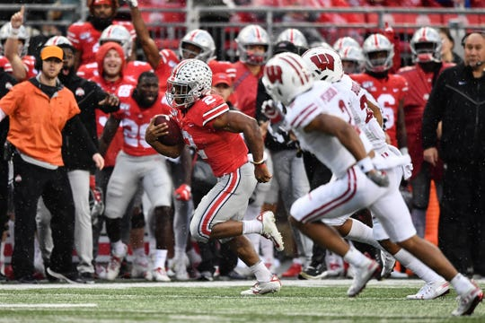 Ohio State's J.K. Dobbins breaks free from the Wisconsin defense for a 34-yard run. The play set up the Buckeyes' third touchdown in their 38-7 victory Oct. 26.