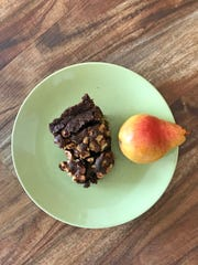Chocolate Loaf Cake with Pears And Hazelnuts bakes up sweet and moist.