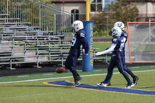 Max Stritzel (59) celebrates after scoring a touchdown for the Kettle Moraine Junior Lasers versus Sussex Oct. 12.