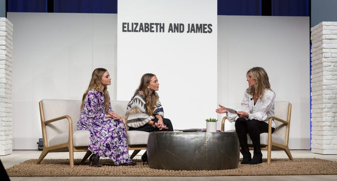 Ashley, left, and Mary-Kate Olsen speak with Kohl's Corp. CEO Michelle Gass during an event at the company's headquarters Friday.