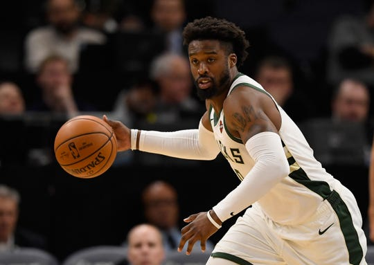 Wesley Matthews dribbles the ball against the Minnesota Timberwolves during the fourth quarter.