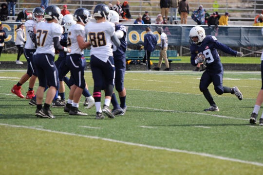 Max Stritzel runs for a touchdown during the Kettle Moraine Junior Lasers' game versus Sussex Oct. 12.