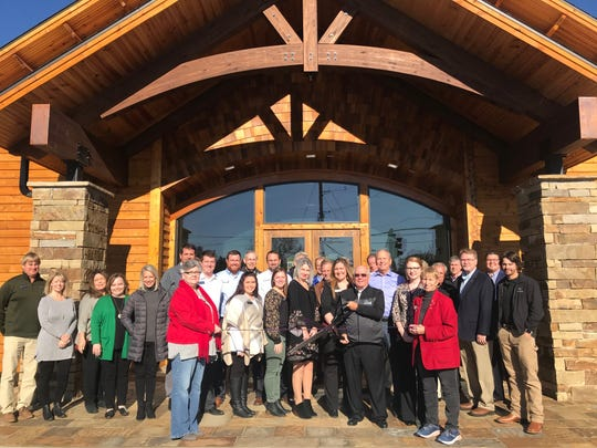 """The Mountain Home Chamber of Commerce recently cutthe ribbon for the opening of Anstaff Bank's newest branch, located at the corner of Wallace Knob Road and U.S. Highway 62/412 in Mountain Home.""""We are excited to bring a second full-service branch to Mountain Home to better serve our customers,"""" said Jerry Cunningham, Market President. """"We are extremely happy with how well the building process went and can't wait to show it off to our customers."""" The new Anstaff location is a full-service branch with a drive-thru and ATM. The lobby is open Monday through Friday from 8 a.m.-5 p.m. The drive-thru is open Monday through Friday from 7:30 a.m. to 5:30 p.m.,as well asSaturday from 9 a.m.-noon.For more information about Anstaff Bank, visit AnstaffBank.com."""