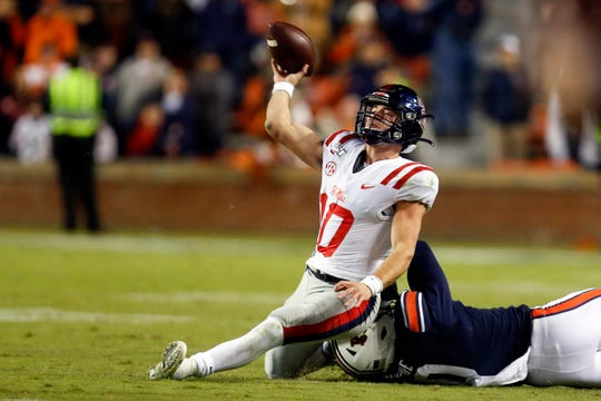 Mississippi quarterback John Rhys Plumlee (10) throws a pass that is intercepted as Auburn linebacker Owen Pappoe (10) tackles him on the final play of an NCAA college football game Saturday, Nov. 2, 2019, in Auburn, Ala. Auburn won 20-14. (AP Photo/Butch Dill)