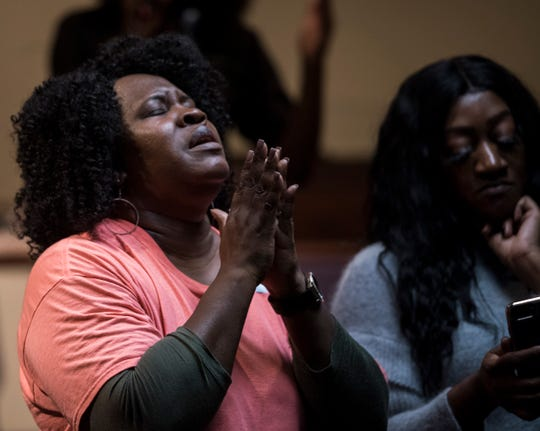Evangelist Wanda Sykes prays during a prayer service for missing Aniah Blanchard at the Open Door Christian Faith Worship Center in Montgomery, Ala., on Monday, Nov. 4, 2019.