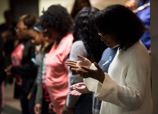 Guest pray during a prayer service for missing Aniah Blanchard at the Open Door Christian Faith Worship Center in Montgomery, Ala., on Monday, Nov. 4, 2019.