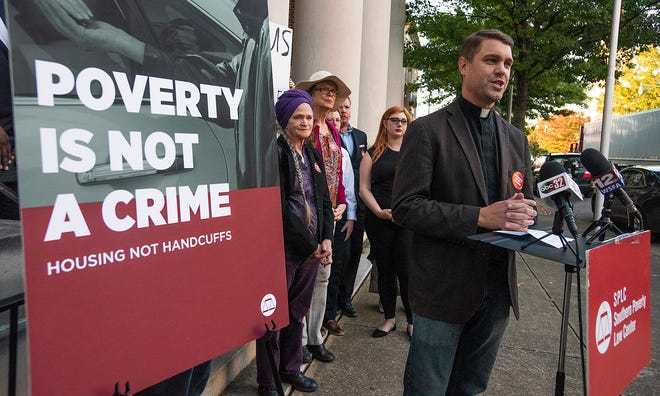 Rev. Shane Isner speaks as the Southern Poverty Law Center and local clergy and supporters hold a press conference denouncing the panhandling ordinance before the city council meeting at city hall in Montgomery, Ala., on Tuesday November 5, 2019.