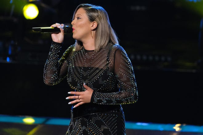 "Ball State alumna Lauren Hall singing Kelly Clarkson's ""Breakaway"" during her knockout round on NBC's ""The Voice."""