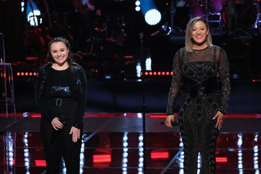 """Ball State alumna Lauren Hall and her knockout round competitor, Kat Hammock listening to judges comments on the Nov. 4 episode of """"The Voice."""""""