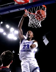 MTSU guard C.J. Jones (23) dunks for two of his 21 points Tuesday against Maryville.