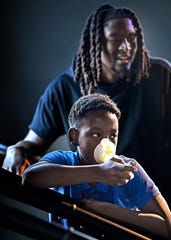 Quinton Beard takes a break from working out on the treadmill with Titans cornerback Tye Smith to catch his breath. Fourth grade students at Buena Vista Elementary went on a fitness and food field trip with Smith Tuesday, Nov. 5, 2019, in Nashville, TN.
