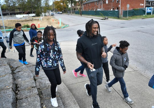 Titans cornerback Tye Smith leads fourth grade students from Buena Vista Elementary through Germantown neighborhoods during a fitness and food field trip Tuesday, Nov. 5, 2019, in Nashville, TN.
