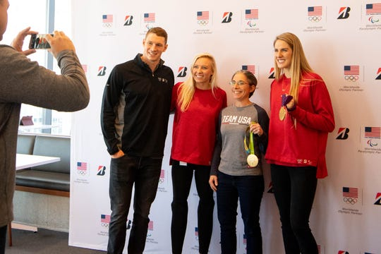 Ryan Murphy, Jessica Long and Missy Franklin pose for a photo during the Olympic and Paralympic Bridgestone Athlete Summit at Bridgestone Tower Tuesday, Nov. 5, 2019 in Nashville, Tenn.