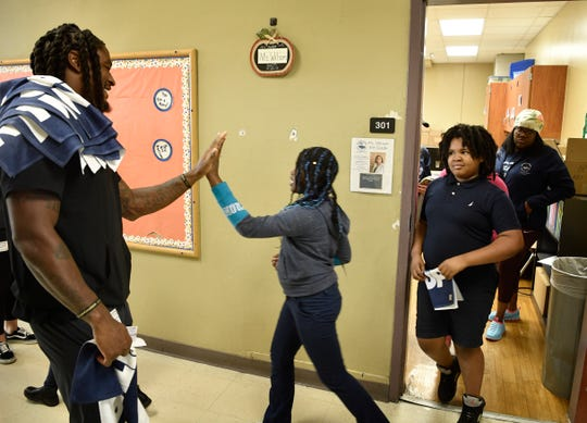 Fourth grade students at Buena Vista Elementary give a high five to Titans cornerback Tye Smith as they leave class for a fitness and food field trip Tuesday, Nov. 5, 2019, in Nashville, TN.