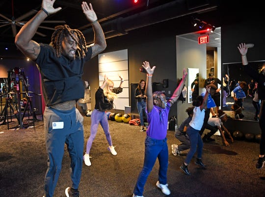 Fourth grade students from Buena Vista Elementary work out with Titans cornerback Tye Smith during a fitness and food field trip Tuesday, Nov. 5, 2019, in Nashville, TN.