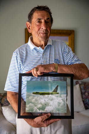Col. Vincent Fazio (Ret.) shows a photo of a B-52D bomber he flew during his service with the U.S. Air Force, Tuesday, Nov. 5, 2019, at his home in Bonita Springs.